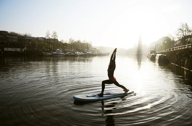 Trying beginner Stand Up Paddle board Yoga